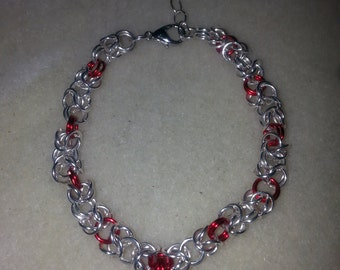 Silver and red love bracelet.