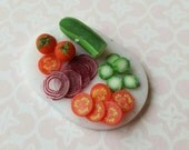 Sliced chopped salad vegetables made from polymer clay in one inch scale, realistic faux food for miniature scenes, 1:12 scale vegetables
