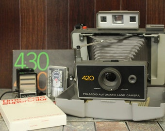 Polaroid 420 Automatic Land Camera with accessories