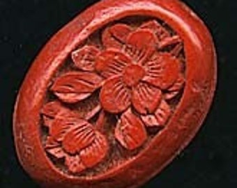 Carved cinnabar oval cabochon. 19x15mm. Pkg of 1. b5-498(e)