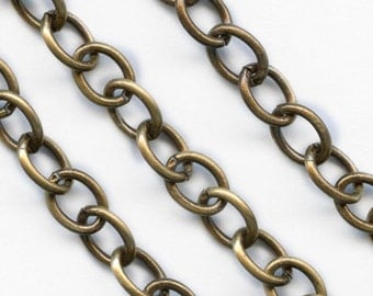 Oxidized solid brass cable chain. 7x5mm links. Sold by the  foot. b12-chn553(e)