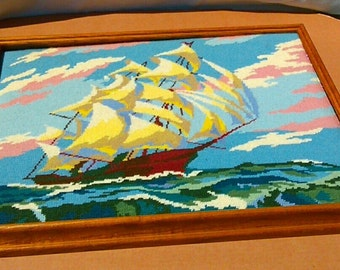 A Vintage English Cross-Stitched Wooden Framed Sail Ship