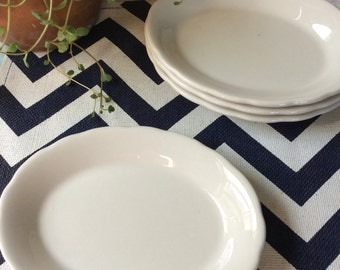 Buffalo China White Oval Plates with Scalloped Edge, set of two.