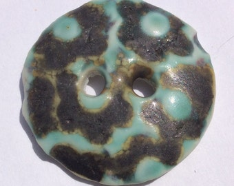 Large, green and burnt midnight green daisy flower motif circula 1 and 3/8-inch porcelain ceramic buttons