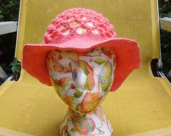Knitted crochet lacy sun hat with adjustable floppy brim in coral pink