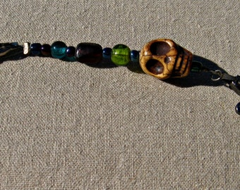 Beaded clip with skull and turtle