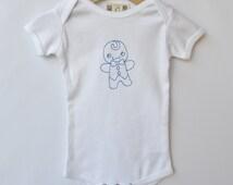 Machine embroidered gingerbread boy on baby boy's bodysuit