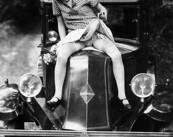 Vintage risque photo sexy woman sitting on antique auto car hood lifting skirt black and white antique photograph 1920s-PRINT