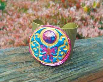 Wide metal cuff in antique brass with hand painted clay butterfly design