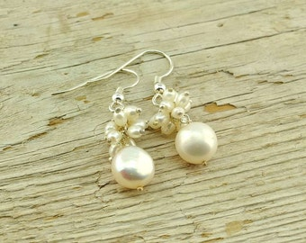 White fresh water pearls and sterling silver earrings.