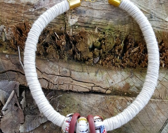 Choker necklace created by using rope climbing beige wool-coated