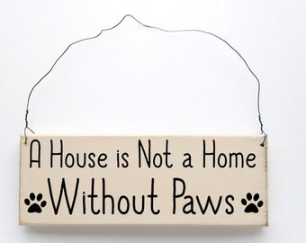 "Wood Sign Saying ""A House is Not A Home Without Paws"" White Wood With Black Lettering"