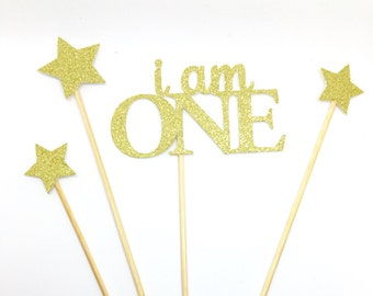 Gold glitter set of i am one cake toppers. With twinkling stars! 1st birthday. Cake smash.