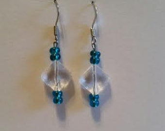 Clear diamond shape earrings with teal glass beads