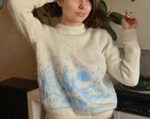 Delicate sweater with winter landscape