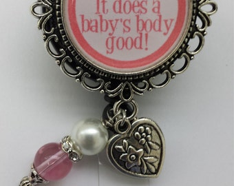 Lactation specialist bottle cap badge holder in pink with heart charm