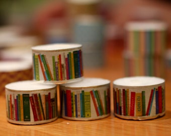 3 extra-tall tea light candles decorated with washi tape in pattern of books library reading literature