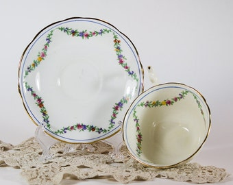 Cream Colored Teacup and Saucer with Flower Garland Design