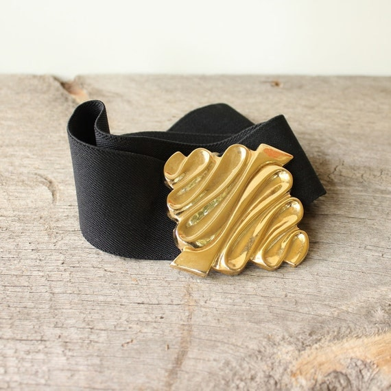 wide black stretch belt with gold buckle 1980s elastic cinch