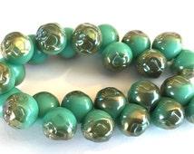 Vintage buttons  (24) Czech glass Green turquoise beads Czech glass Rose imprint iridescent 10mm (24)