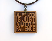 GUNS N ROSES Wood Lyric Necklace - All We Need Is Just A Little Patience