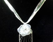 Stunning pearlized rose on woven silvertone weave pendant with free coordinating ribbon cord!