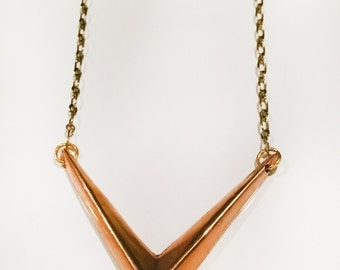 V Emblem Necklace in White/Gold Bronze