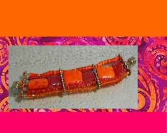 The Indigo Daisy Multistrand Southwestern Style Hot Pink and Orange Bracelet Free Shipping.