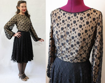 1960s black polka dot dress with nude illusion bodice and balloon sleeves by Harou