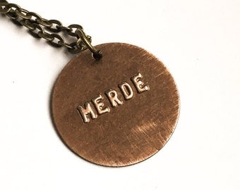 MERDE Stamped Metal Pendant with Brass Chain