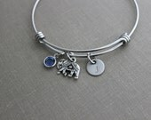 stainless steel adjustable lucky bangle bracelet with pewter elephant charm,  personalized initial disc and Swarovski crystal birthstone
