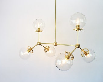 Modern Brass Chandelier, 6 Clear Glass Globes, Large Hanging Lighting Fixture, Unique Statement Lighting and Home Decor
