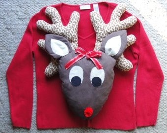 3D Rudolph the Red Nosed Reindeer Makes This Ugly Christmas Sweater a Real Standout