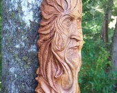 one-of-a-kind gothic green man, hand carved wood spirit for wall decor in a living room