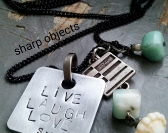 Live Laugh Love - stamped motivational tag, carved bone, cornflower blue glass & silver charm chain necklace