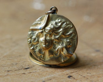 Antique Art Nouveau repoussé lady locket with initials