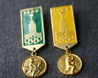 Vintage Moscow Olympics pins duo. Sport event medal collectible memorabilia.