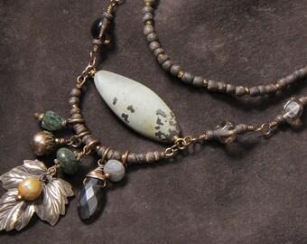Cottonwood Canyon: jasper, wood, smoky quartz, serpentine, pearl, apatite, leather