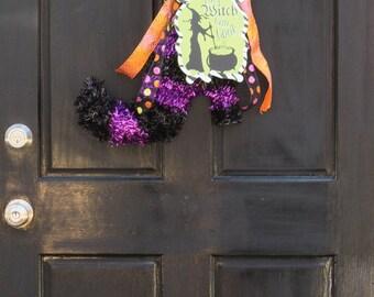Halloween tinsel witch boot door ornament