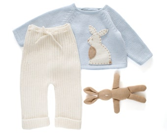 Knitted sweater and ribbed pants in soft blue and off white with a felt rabbit. 100% merino wool. READY TO SHIP in size Newborn.