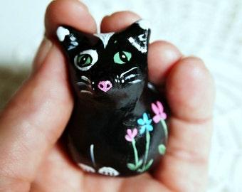 black cat animal totem, tuxedo cat, clay sculpture, flower painting, miniature clay animals, botanical print