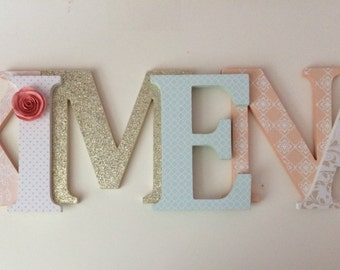 Wooden  letters for nursery in peach, gold, mint and white.