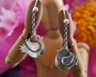 Cut little frilly bird earrings hand made from fine silver and hung silver chain and sterling silver wires.