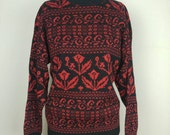 Black and metallic red oversized sweater