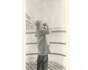 """Vintage Snapshot """"Searching"""" Young Boy With Binoculars - Boardwalk At The Beach - Wearing Winter Coat And Hat - Found Vernacular Photo"""
