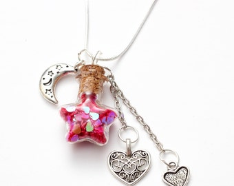 Love Potion Necklace - red hearts in a star shaped vial bottle with moon and heart charms