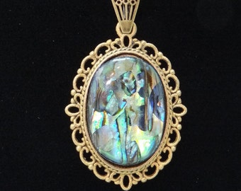 j3323 Paua Shell Pendant in Antique Bronze. Paua shell is also known as abalone.