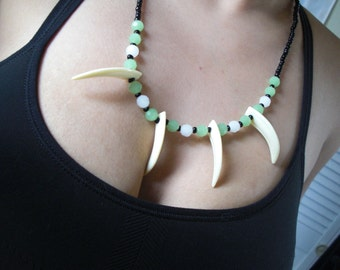 Amazon fang/claw white and green beaded necklace