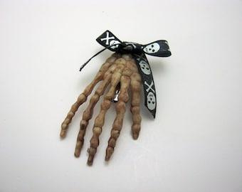 Skull Bow Hand Hair Barrette