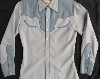 Vintage Nathan Turk men's western shirt. Grey w/ grey striped yokes and cuffs, Blue piping and smile pockets. Small to Medium S-M.